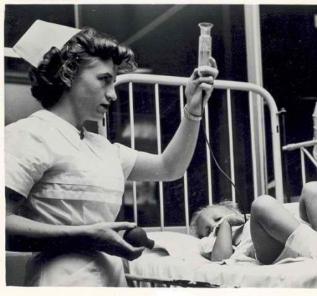 Nurse with patient, St. Louis Children's Hospital, 1956.