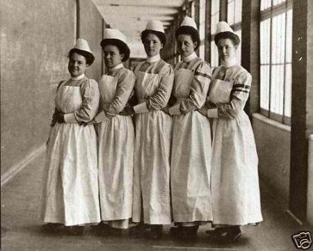 Nurses wearing early Nursing uniforms