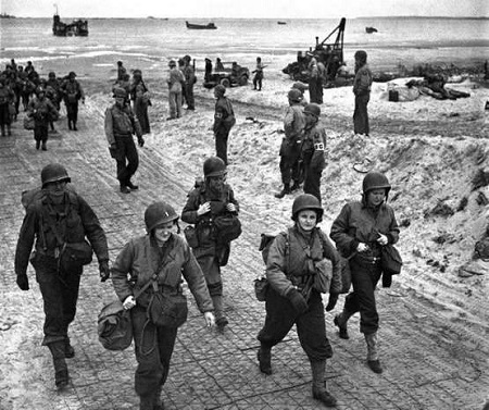 U.S. nurses walk along a beach in Normandy, France on July 4, 1944