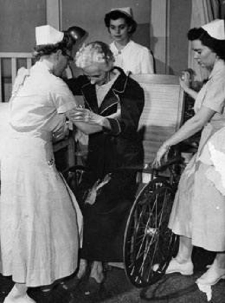 Vanderbilt nursing students aiding an elderly patient during hospital clinicals