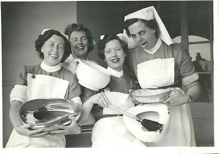 Vintage nurses having some bedpan humor.