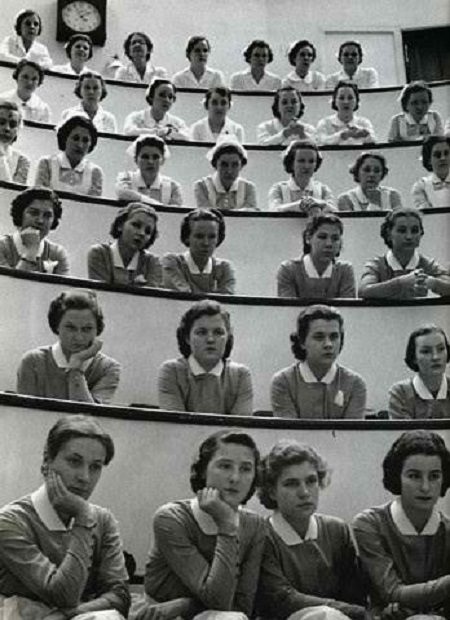 Vintage nurses listening to a discussion.
