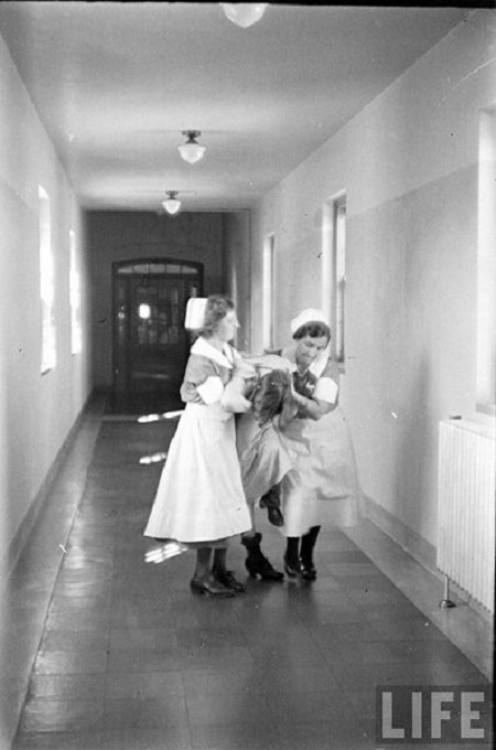 Vintage nurses working in a mental hospital, 1936.