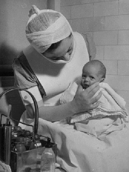 Vintage photo of a nurse with a premature baby