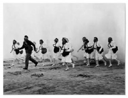 WWII photo of U.S. Army nurses getting trained to use of gas masks